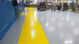 Epoxy Flooring in Industrial Building with Colored Aisleway